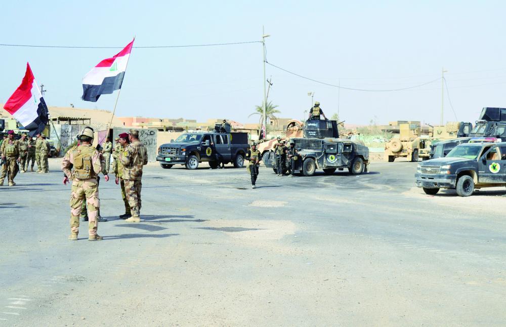 العراق يطهر آخر بلدة من داعش - صحيفة مكة